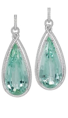 Chopard. Earrings from the Temptations Collection, suspending two pear shaped green beryls paved with diamonds and set in white gold.
