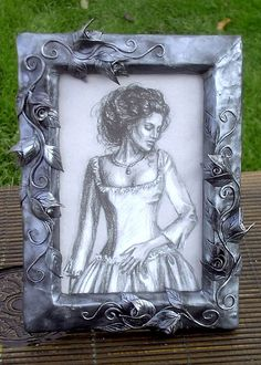 Photo frame with drawing by MaevinWren (via Flickr)
