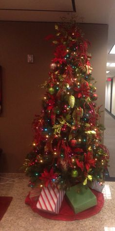 Multi Colored light Christmas tree with the Traditional Christmas color ornaments