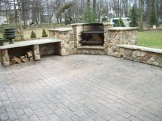 Cobblestone stamped concrete patio with outdoor fireplace grill combo