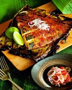 Grilled spicy skate wing in banana leaf
