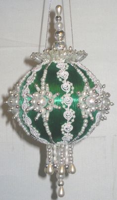*I could do white on the red thread balls I have. Maybe add gold instead of the white lace, though-- wouldn't get as dirty. -- JLM
