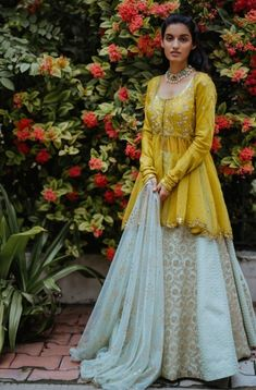 Beautiful dress with lehenga and peplum blouse. Embellished with hand work. Party Wear Indian Dresses, Designer Party Wear Dresses, Indian Fashion Dresses, Dress Indian Style, Indian Designer Outfits, Indian Outfits, Indian Gowns, Designer Wear, Stylish Dress Designs