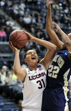 UConn center Stefanie Dolson shoots for two of her 11 first-half points against Prairie View forward Larissa Scott. 3-23-14