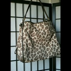 leopard coach edie bag hard to find (last pic 4 sz This is the second listing to go along with my coach leopard purse that's for sale these are better clearer picture is in the other picture this thing it does have the Creed posted I only have room for 4 pictures so you would have to look at both of those things to get all of the information and details please ask me any questions and the price is slightly negotiable but I'll only take reasonable offers my closet is smoke-free and this bag…