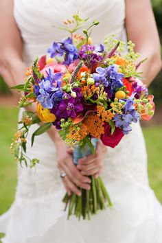 bridal bouquet purple Spring wedding ideas--Elegant orange and purple/blue and greenery wedding bouquets, diy bridal bouquets on a budget, boho rustic wedding theme, elegant Ranunculus Wedding Bouquet, Purple Wedding Bouquets, Bride Bouquets, Bouquet Wedding, Flower Bouquets, Cascading Bouquets, Spring Flower Bouquet, Bright Wedding Flowers, Bridal Flowers