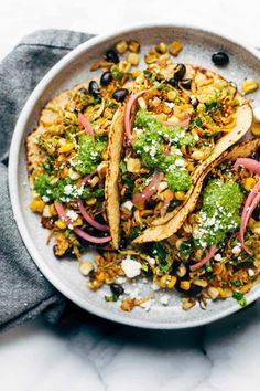 Brussels sprouts tacos: Savory sautéed shredded brussels sprouts tucked into charred tortillas with roasted corn, jalapeno, black bean, and cilantro chimichurri.