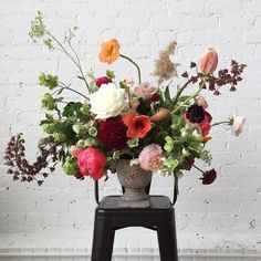 Beautifully eclectic floral arrangement designed by Sachi Rose