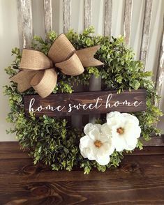 Boxwood floral wreath with burlap bow and wooden welcome sign, diy wreath decor inspiration