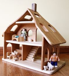 beautiful cherry wood dollhouse and dolls