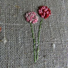 For pom pom flowers use circular buttonhole stitch, or clusters of French and Colonial knots . (pattern by lili_popo, via Flickr)