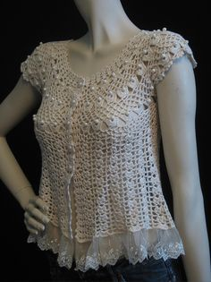 "https://flic.kr/p/88t1pu | Crochet Baby Doll Top | Sweet circa 1980s hand crocheted baby doll top adorned with pearl-like beads and trimmed in lace. There are no labels, but it is very well made and has been crocheted in one piece. It does up with five pearly white buttons and can be dressed up or down for day or evening. Love it!   Photographed on a 5'9"" size 3,4 mannequin.  Vintage size label: none, but we think this will best fit an XXS to XS"