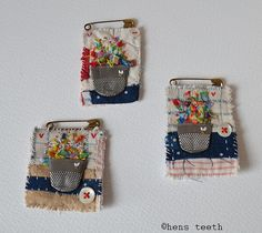 teeny brooches - love the flattened thimble as a flower pot