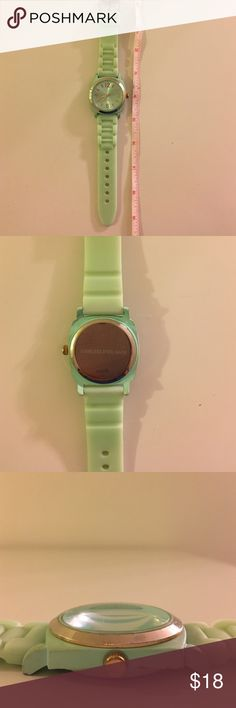 Anthropologie Viscid Watch Soft, rubber like watch band with oversized face. Mint/seafoam green color with gold accents. Needs battery. Small scratches on side of face (seen in photos). Comfortable, cute add-on to a good stack of gold bracelets! Anthropologie Accessories Watches