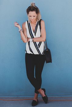 spring / summer - street chic style - street style - summer outfits - casual outfits - black and white striped surplice top + black skinny jeans + black loafers + black shoulder bag