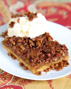 Gooey Pecan Bars - cake mix crust topped with yummy pecan pie filling. Serve warm with ice cream!