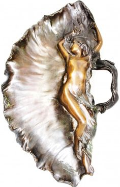 """ALFRED-JEAN FORETAY BRONZE ART NOUVEAU NUDE - Alfred Jean Foretay (SWISS 1861-1944). Shell shaped bronze tray or wall plaque depicting a nude female laying down. Signed to lip. Nice brown and green patina. Measures 11"""" width x 19"""" length (27.9cm x 48.2cm)."""