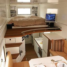 Inside a fully loaded tiny house with double raised sleeping and eating sections