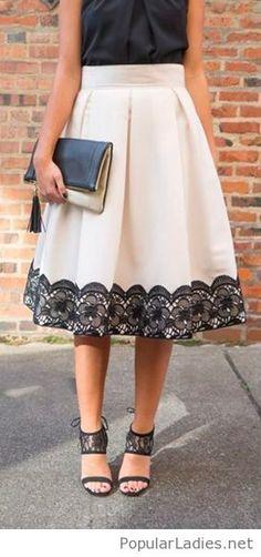 Black top, nude midi skirt , high heels and a bag