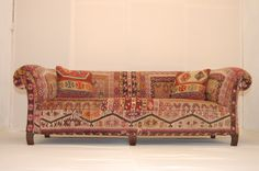 Old Chesterfield sofa upholstered in an Antique Anatolian Kilim rug by The Family Seat. #upholstery #sofa #interiors https://twitter.com/TheFamilySeat