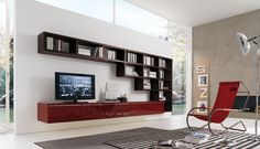 Artificial wall mounted tv unit with storage space, still allowing plenty of natural light