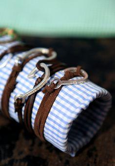 Lander Urquijo : Weekend accessories: Silver Hook Bracelets on brown leather
