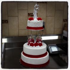 3 tier wedding cake. Red and white with wine glasses. Buttercream icing only. Valentina's Day Wedding Cake.