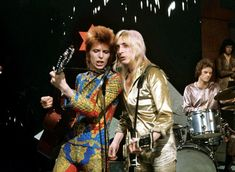 David Bowie's drummer has revealed how he was sacked over the phone on his wedding day. Woody Woodmansey played with Ziggy Stardust, and was dropped when Bowie ditched the persona. David Bowie Starman, David Bowie Ziggy, Lady Stardust, Ziggy Stardust, Bbc News, Trevor Bolder, Moonage Daydream, Mick Ronson, Bohemia