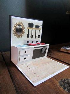 こちらは切り込みも入れずに折る方向を変えただけで立体的なキッチンのできあがり。 お料理好きの友人にいかが?