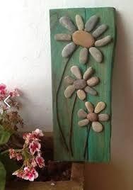 Resultado de imagen para manualidades hechas con piedras de rio