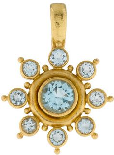18K yellow gold Elizabeth Locke pendant with hammered finish featuring bezel set faceted blue topaz and bail with safety hinge closure.
