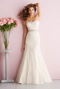 Allure Romance . Lacy and feminine, this strapless gown features a Swarovksi crystal belt and a chapel length train.��See Allure Bridals on YouTube