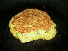 Zucchini Pancakes    Zucchini Pancakes    1 medium zucchini grated (about 2 cups)  6-8 T Flour  1/4 cup onion  1 clove garlic- minced  2 eggs- slightly beaten  salt and pepper  butter for frying    Place the zucchini in a bowl and mix in the eggs. Add onion, garlic, salt and pepper. Mix in 6 T of flour, if it still very wet add the additional flour.    Preheat a skillet on medium, place a small amout of butter in the pan (or olive oil) and spoon about 1/4 cup of batter in the pan. Cook 2 min…