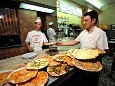 Rome - Must try!    Cafeteria-style seating, it is perpetually packed and always understaffed, but the pizza's so good that you won't even care. Ai Marmi serves classic Roman-style pizza, with a thin, charred, crisp crust and a cheesy, sauce-laden middle.