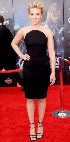 Look of the Day › April 12, 2012 WHAT SHE WORE Scarlett Johansson added Van Cleef & Arpels diamonds and patent leather stilettos to her Versace peplum dress at the premiere of The Avengers. WHY WE LOVE IT The actress channeled her inner Black Widow in a fierce, curve-enhancing LBD.