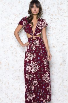 Featuring floral print allover, cutouts at waist, short sleeves, deep v neck, slit at side