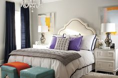 Inspiration room...mix of dark blue drape and trim on bedding, pops of purple pillows, turquoise blue ottomans...some gray too and lots of white...then the yellow/orange thrown in... so cool