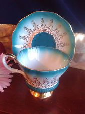 Royal Albert Turquoise Tea Cup and Saucer Overture Series Gold Filigree Footed