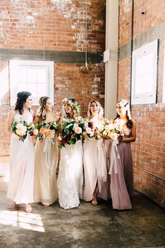 bridesmaids' dresses - photo by Plum and Oak Photo http://ruffledblog.com/a-must-see-industrial-wedding-with-gorgeous-florals