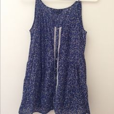 Levi's blue button down tank top size small worn only twice, in great condition  Length: 26.5 inches bust: 15.5 inches (relaxed)  100% Cotton Make a bundle and receive a discount!!  Levi's Tops Button Down Shirts