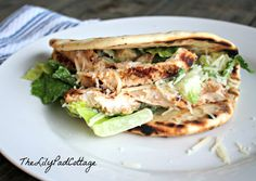 Chicken Caesar pita recipe - she grills the chicken and then uses bagged Caesar Salad Kit