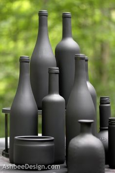 Upcycle Wine Bottles • would be good spray painted in silver and gold for holiday centerpiece. All different heights/sizes