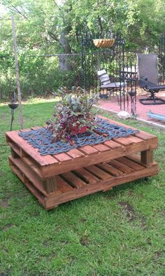 2 free pallets,4 casters,finally stained.added a wrought iron fireplace screen and a plant! I'm Happy :0)