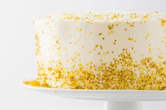 Not only is this cake covered in edible gold confetti, but it's got champagne IN it too! :)