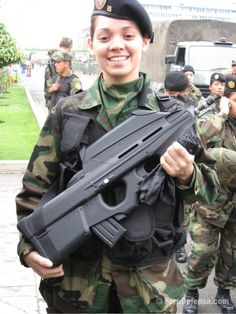 Brazilian Female Soldier Switchblade - bigswitchbladeknife.com likes this