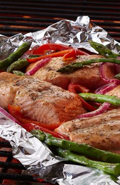 Grill salmon, fresh summer vegetables, butter and lemon zest in a foil pouch for an easy and delicious summer meal.