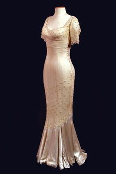 """Styled after the dress worn my Marilyn Monroe in ''The Prince and the Showgirl""""  Cream satin mermaid gown, short sleeves, back zipper. Would make a gorgeous wedding gown,"""