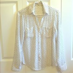 Express shirt XS Sheer white button down shirt covered with tiny black stars. Two pockets on the front. Size extra small. 100% polyester. In excellent condition. Express Tops Button Down Shirts