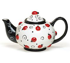 """Handwash only/FDA approved. Ladybugs & Swirls hand-painted raised ceramic teapots. 6 1/2""""H X 2""""Opening. Holds 46 oz. Individually gift boxed."""