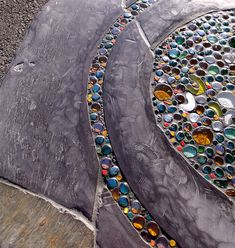 I've always loved the way gems look in the light what a beautiful stark contrast with the slate.   Gems and slate - Helen Nock